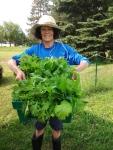Sister harvesting greens